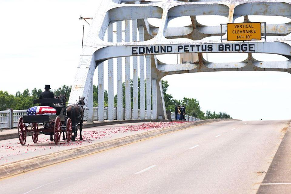 <p>The horse-drawn carriage with Lewis's casket crossed the Edmund Pettus Bridge, following a trail of red rose petals. Since Lewis's death, there have been calls to rename the bridge after the Civil Rights icon, as Pettus himself was the leader of the Alabama Ku Klux Klan. <br></p>