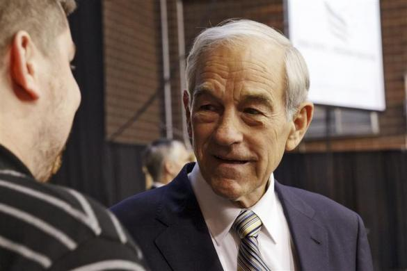 Ron Paul greets supporters before he speaks at the Iowa Faith & Freedom Coalition's Presidential Forum at the Iowa State Fairgrounds in Des Moines, Iowa October 22, 2011. (REUTERS/Brian C. Frank)