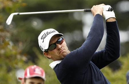 Australia's Adam Scott plays a shot during the final round of the World Cup of Golf at The Royal Melbourne Golf Club in Melbourne November 24, 2013. REUTERS/Brandon Malone
