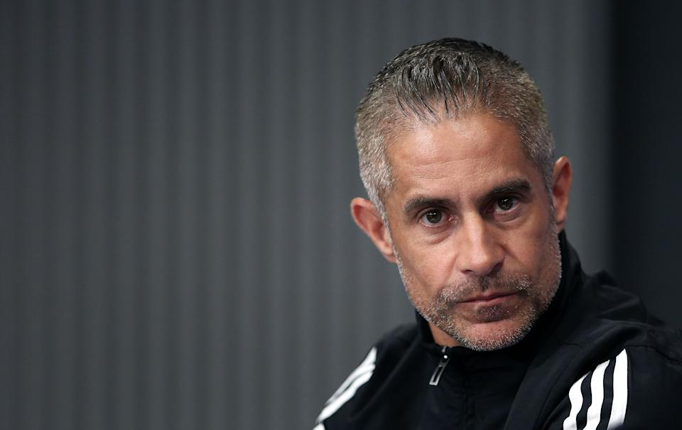 Lyon's Brazilian coach Sylvinho addresses a press conference on the eve of the UEFA Champions League Group G football match RB Leipzig v Lyon in Leipzig, eastern Germany, on October 1, 2019. (Photo by Ronny Hartmann / AFP)        (Photo credit should read RONNY HARTMANN/AFP via Getty Images)