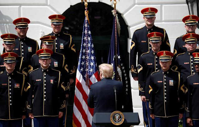 "U.S. President Donald Trump applauds the United States Army Chorus at his ""celebration of America"" event on the South Lawn of the White House in Washington, U.S., June 5, 2018. The event was arranged after Trump canceled the planned visit of the Super Bowl champion Philadelphia Eagles to the White House. REUTERS/Kevin Lamarque"