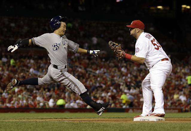 St. Louis Cardinals first baseman Matt Adams, right, catches the throw on a bunt ground out by Milwaukee Brewers' Norichika Aoki, left, during the seventh inning of a baseball game, Thursday, Sept. 12, 2013, in St. Louis. (AP Photo/Jeff Roberson)