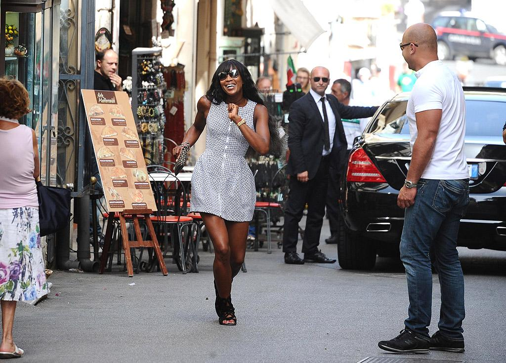 "<p class=""first"">Supermodel Naomi Campbell may have developed a reputation for her short temper and bursts of bizarre violence (cell-phone throwing, anyone?), but on Tuesday she was spotted with a new and rather festive demeanor as she danced though the streets of Taormina, Italy. The 42-year-old beauty was there on vacation with her handsome billionaire boyfriend, Russian real estate mogul Vladislav Doronin. (7/10/2012) </p>"