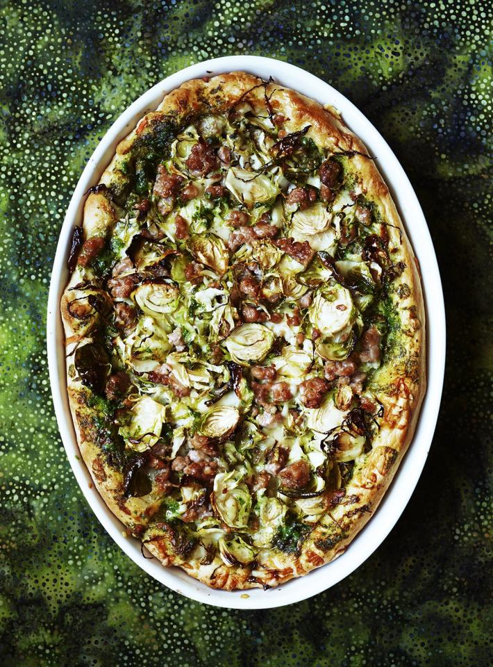 """<p>Trust us—once you've tried this technique once, you'll be asked to bring it to every game. The key to making deep-dish pizza at home is to line a 9-by-13-inch baking dish with dough. After covering the bottom and the sides with the dough, fill it with pesto, <em>lots</em> of shredded cheese, crumbled turkey sausage, and thinly sliced Brussels sprouts. As it bakes, the crust will crisp, the sausage will cook, and the cheese will melt and bubble.</p> <p> <strong>Get the recipe:</strong> <a href=""""https://www.realsimple.com/food-recipes/browse-all-recipes/deep-dish-pizza-turkey-sausage-brussels-sprouts"""" target=""""_blank"""">Deep-Dish Pizza With Turkey Sausage and Brussels Sprouts</a></p>"""
