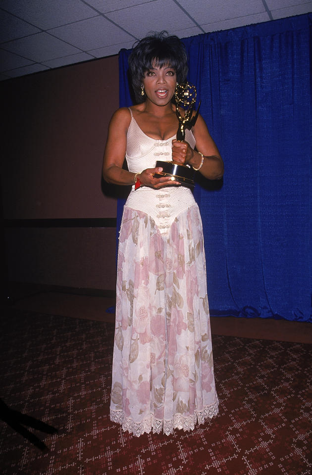 <p>The queen of daytime TV, Oprah Winfrey, looked flawless when she accepted her Emmy Award in 1994 in this baby pink corseted dress with a see-through skirt. Photo: Getty Images </p>