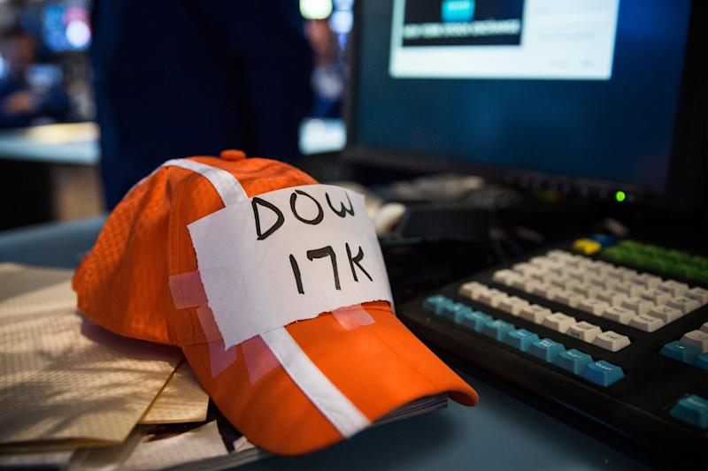 A trader's modified hat reads Dow 17K on the floor of the New York Stock Exchange during the morning of July 3, 2014 in New York City