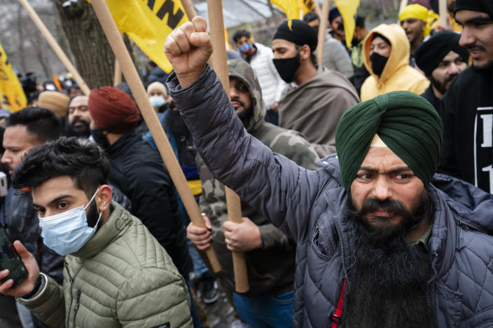 Protesters gather on Fifth Avenue outside the Consulate General of India, Tuesday, Jan. 26, 2021, in the Manhattan borough of New York. Tens of thousands of protesting farmers have marched, rode horses and drove long lines of tractors into India's capital, breaking through police barricades to storm the historic Red Fort. The farmers have been demanding the withdrawal of new laws that they say will favor large corporate farms and devastate the earnings of smaller scale farmers. Republic Day marks the anniversary of the adoption of India's constitution on Jan. 26, 1950. (AP Photo/John Minchillo)