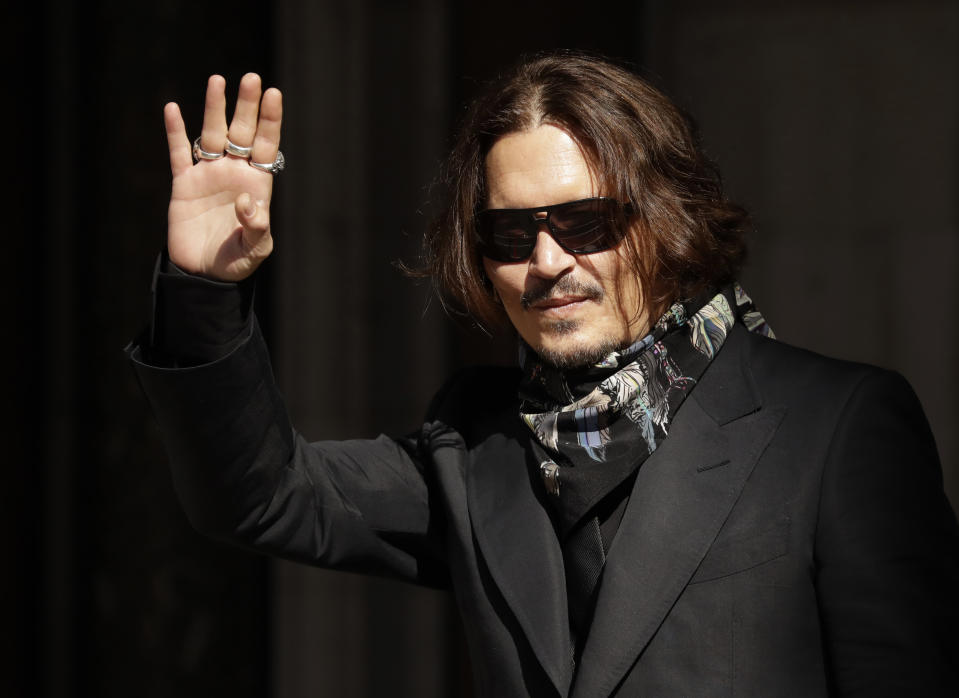 Actor Johnny Depp arrives at the High Court in London, Monday, July 20, 2020. Amber Heard started Monday to give evidence at the High Court in London as part of Johnny Depp's libel case against The Sun over allegations of domestic violence during the couple's relationship. (AP Photo/Matt Dunham)