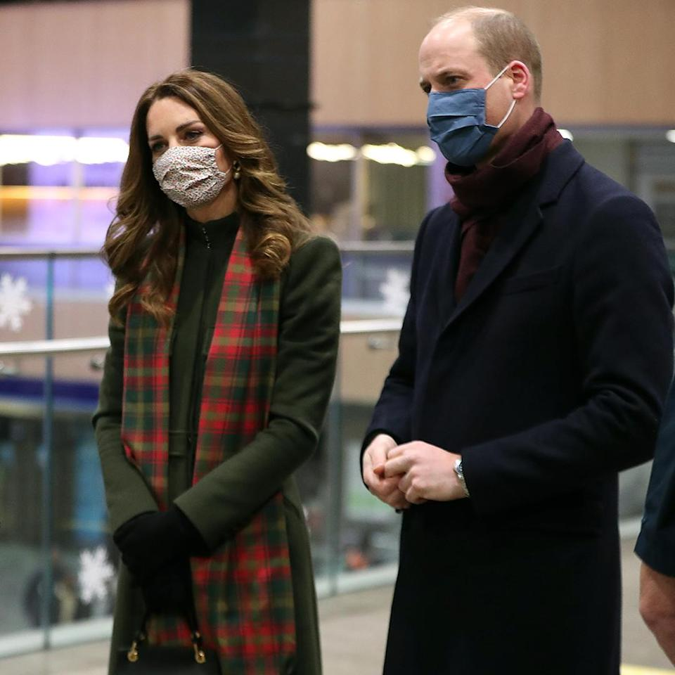 <p>The royal's tartan scarf provided a hint of where the couple were kicking off their train tour: with a stop in Edinburgh, Scotland!</p>