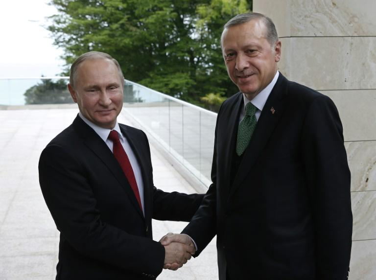 Russian President Vladimir Putin (L) welcomes his Turkish counterpart Recep Tayyip Erdogan during their meeting at the Bocharov Ruchei state residence in Sochi on May 3, 2017