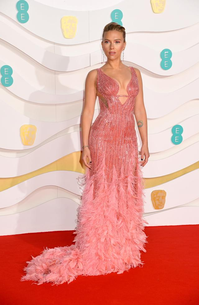 The actress opted for a gorgeous Versace dress [Image: Getty]