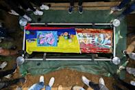 Relatives and friends gather around the coffin of Nicolas Guerrero, killed in the city of Cali during a clash with riot police in an anti-government demonstration