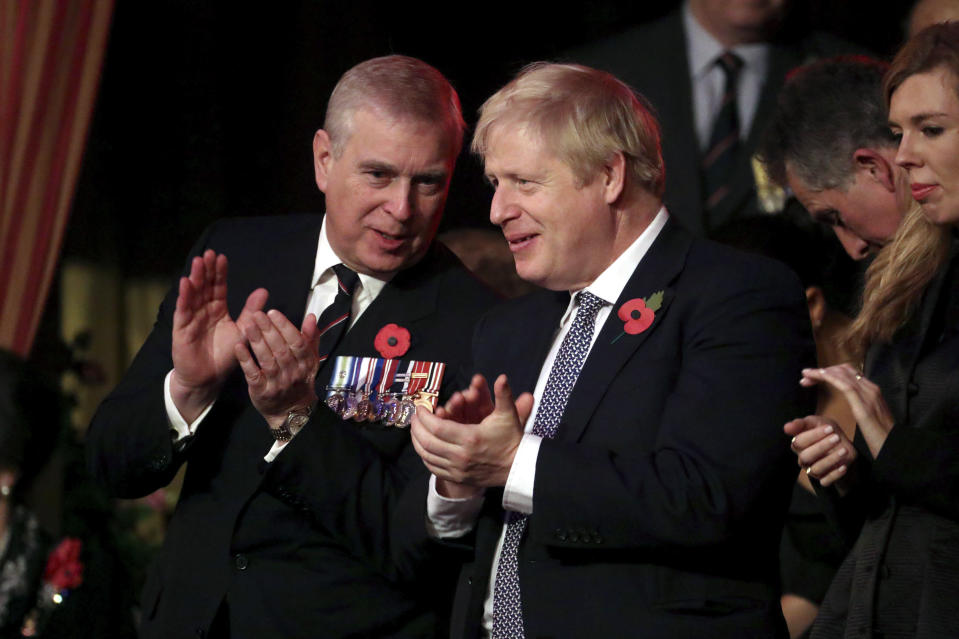 Britain's Prime Minister Boris Johnson, right, talks with Prince Andrew as they attend the annual Royal British Legion Festival of Remembrance, at the Royal Albert Hall in Kensington, London, Saturday, Nov. 9, 2019. (Chris Jackson/Pool Photo via AP)