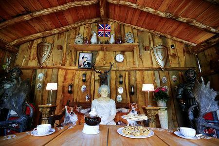 """Short bread is placed in front of a Queen Elizabeth model at """"Robin Hood's hut"""" of the British curiosity collection called """"Little Britain"""" of Gary Blackburn, a 53-year-old tree surgeon from Lincolnshire, Britain, in Linz-Kretzhaus, south of Germany's former capital Bonn, Germany, August 24, 2017. REUTERS/Wolfgang Rattay"""