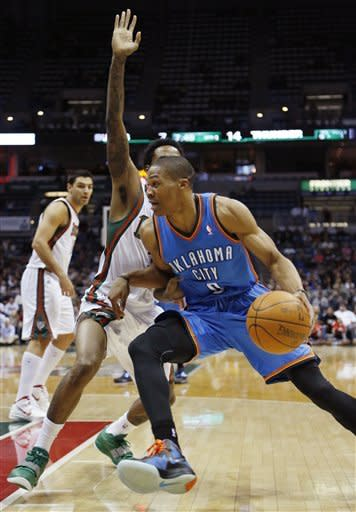 Oklahoma City Thunders' Russell Westbrook(0) drives against Milwaukee Bucks' Brandon Jennings during the first half of an NBA basketball game Monday, April 9, 2012, in Milwaukee. (AP Photo/Jeffrey Phelps)