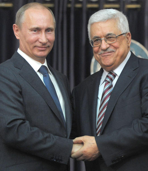 """Russian President Vladimir Putin, left, and Palestinian President Mahmoud Abbas, right, shake hands during a media briefing following their meeting, in the West Bank town of Bethlehem, Tuesday, June 26, 2012. Visiting Russian President Vladimir Putin praised his Palestinian counterpart Tuesday for what he said was a """"responsible"""" position in negotiations with Israel, frozen for nearly four years, and said Russia has no problem recognizing a Palestinian state. (AP Photo/RIA Novosti, Alexei Druzhinin, Presidential Press Service)"""