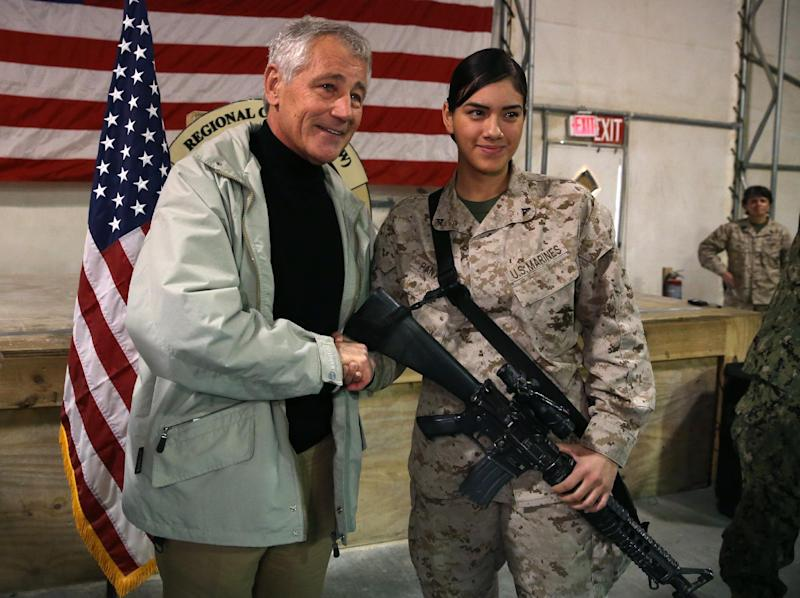 U.S. Secretary of Defense Chuck Hagel poses for a photograph with U.S. Marine Jessica Pantoja at Camp Bastion, Afghanistan, Sunday, Dec. 8, 2013. Hagel spoke with troops and thanked them for being deployed for the holidays. (AP Photo/Mark Wilson, Pool)