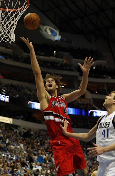 Portland Trail Blazers center Robin Lopez (42) shoots as Dallas Mavericks forward Dirk Nowitzki (41), of Germany, defends during the first half of an NBA basketball game on Friday, March 7, 2014, in Dallas. (AP Photo/John F. Rhodes)