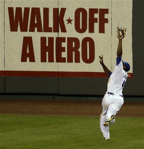 Kansas City Royals center fielder Lorenzo Cain catches a fly ball hit by Texas Rangers' Nelson Cruz to end the eighth inning of a baseball game, Thursday, Sept. 6, 2012, in Kansas City, Mo. (AP Photo/Charlie Riedel)