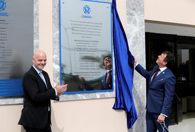FIFA President Gianni Infantino and CONMEBOL President Alejandro Dominguez attend the inauguration of a plaque of the new works in the Conmebol building, one day before at the 69th CONMEBOL Ordinary Congress at their headquarters in Luque, Paraguay May 10, 2018. REUTERS/Jorge Adorno