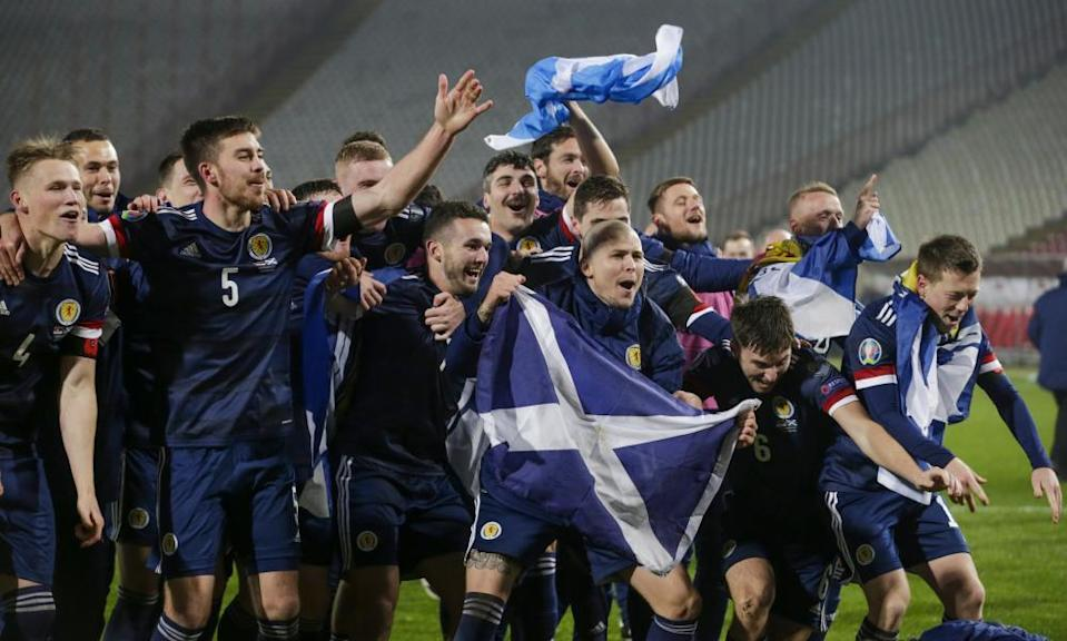 Scotland's players celebrate after beating Serbia on penalties to seal their qualification for Euro 2020.