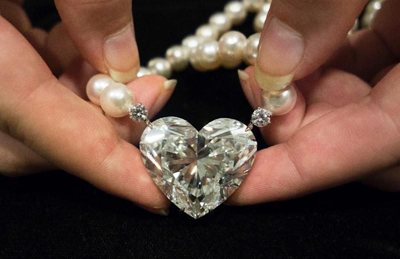 'La Legende' heart-shaped 92-carat diamond is displayed at Christie's in New York on May 3, 2017