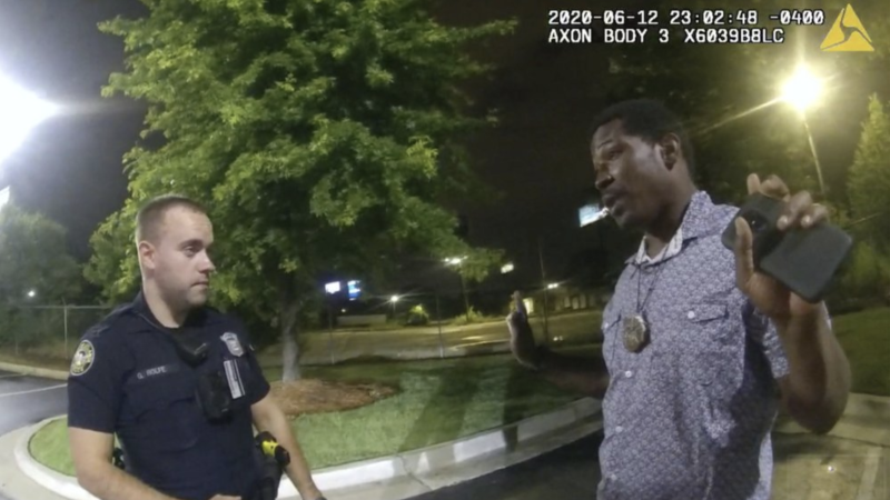 A body cam image showing Rayshard Brooks speaking with Officer Garrett Rolfe (left) before the fatal shooting. Source: AP