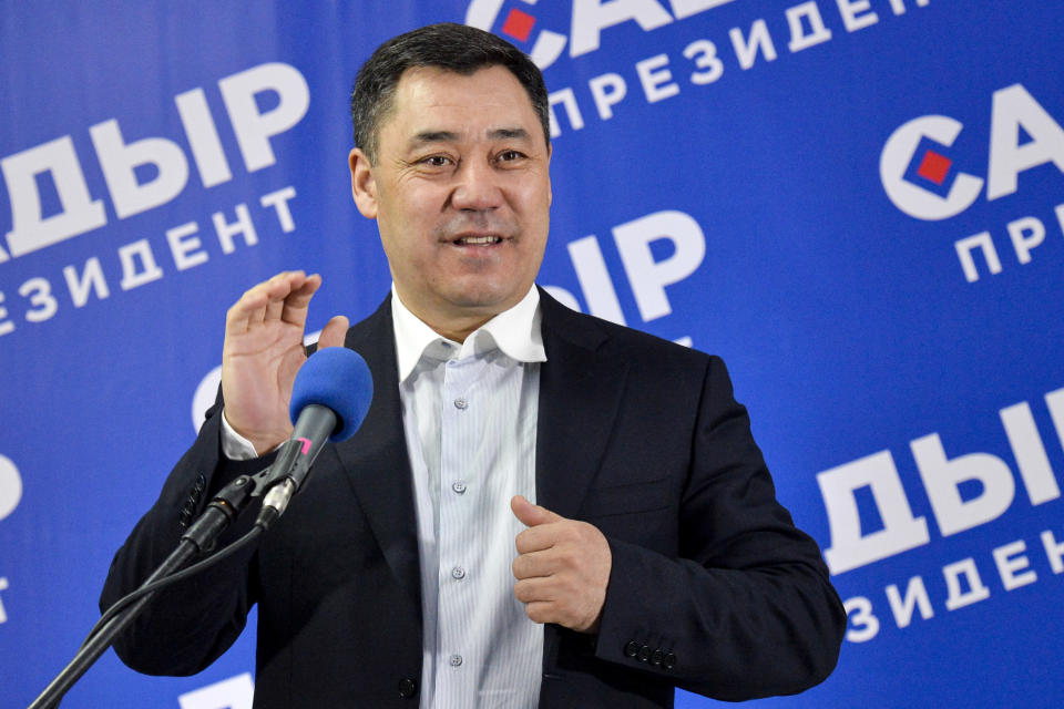 Sadyr Zhaparov, the top presidential candidate gestures while speaking to the media after the presidential election in Bishkek, Kyrgyzstan, Sunday, Jan. 10, 2021. A nationalist politician who was released from prison amid protests that overthrew Kyrgyzstan's president last year has been elected as his replacement. Voters in Sunday's election that gave Sadyr Zhaparov a landslide victory also approved a referendum to change the constitution to give the presidency more power. (AP Photo/Vladimir Voronin)