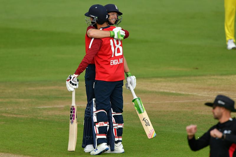 England's Jos Buttler (L) embraces England's Moeen Ali (R) as England celebrate their victory in the international Twenty20 cricket match between England and Australia.