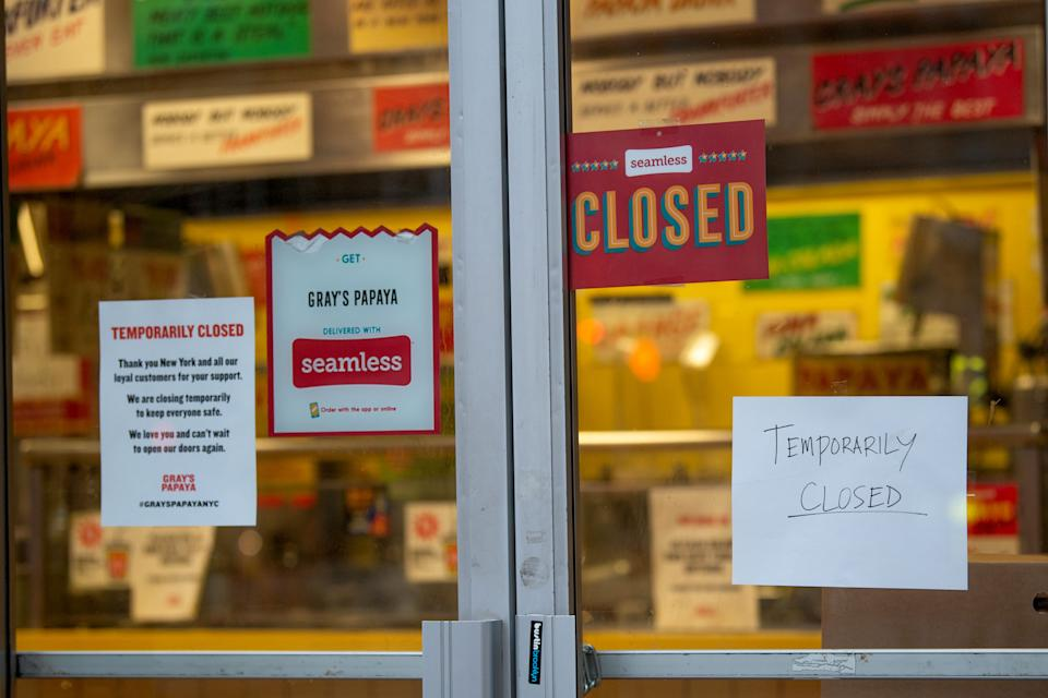 NEW YORK, NEW YORK - APRIL 24:  Closed signs hang on a fast food restaurant amid the coronavirus pandemic on April 24, 2020 in New York City, United States. COVID-19 has spread to most countries around the world, claiming over 196,000 lives with over 2.8 million cases. (Photo by Alexi Rosenfeld/Getty Images)