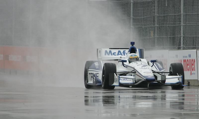 Driver Sebastien Bourdais of France, takes turn one during practice for the IndyCar auto race on Belle Isle in Detroit, Friday, June 1, 2012. (AP Photo/Dave Frechette)