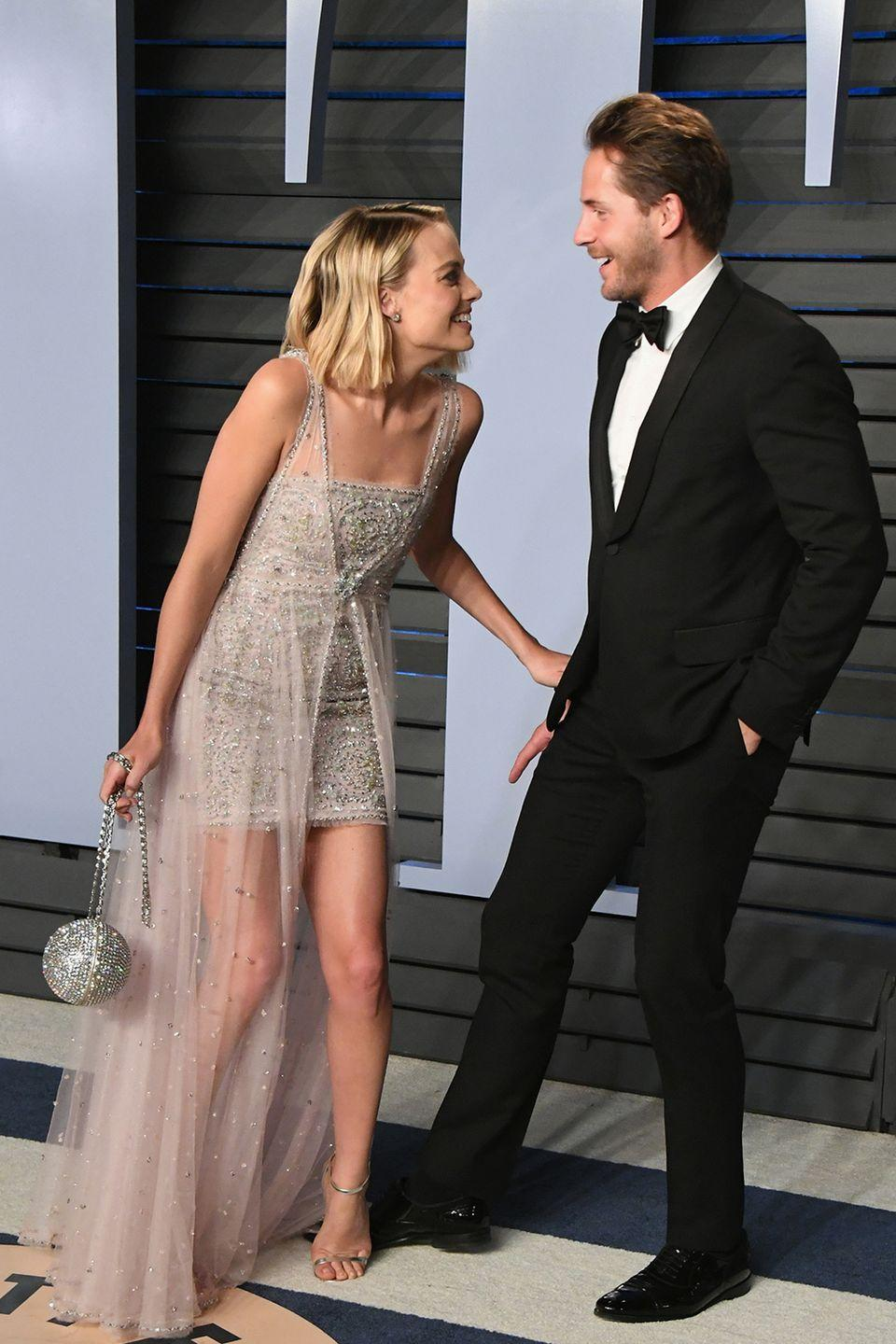 """<p><strong>How long they've been together:</strong> The duo met on the set of <em>Suite Franchise</em> in 2013—Robbie was a supporting actress and Ackerley an assistant director. After moving from friends, to roommates, to an official couple, Margot and Ackerley wed in a secret ceremony in 2016. When asked about meeting Ackerley, Margot told <em>Vogue</em>, """"We were friends for so long. I was always in love with him, but I thought, <em>Oh, he would never love me back. Don't make it weird, Margot</em>…And then it happened, and I was like, <em>Of course we're together. This makes so much sense, the way nothing has ever made sense before</em>.""""<br></p><p><strong>Why you forgot they're together:</strong> One of the reasons Margot comes across as so cool and laid back is because, well, she really is that cool and laid back. The actress rarely posts photos with her producer husband, and they keep their red-carpet PDA to a minimum. (Though they look particularly cute here.)<br></p>"""