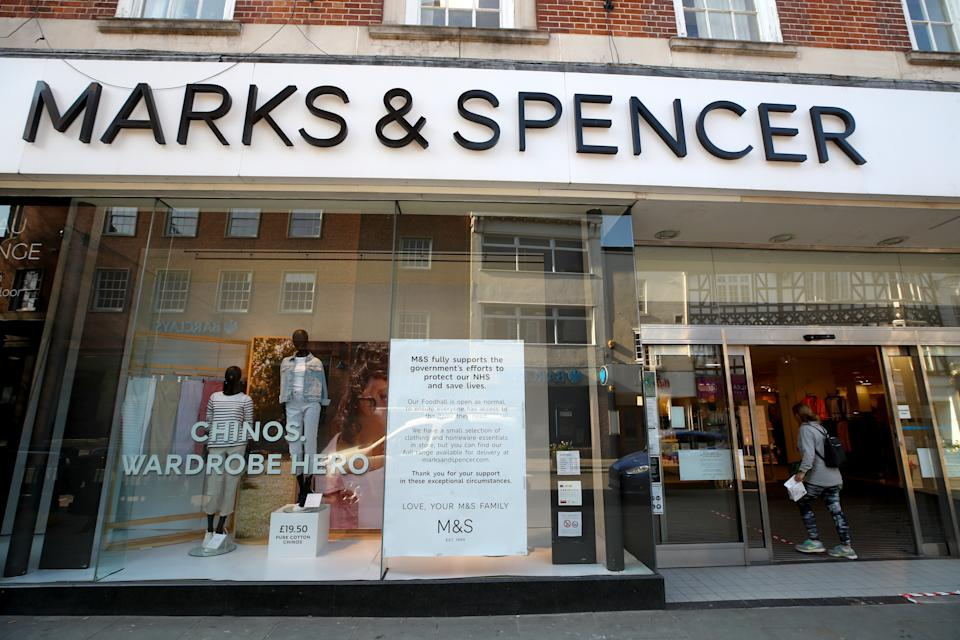 A woman enters a Marks and Spencer store where the food hall remains open in Shrewsbury as the UK continues in lockdown to help curb the spread of the coronavirus.