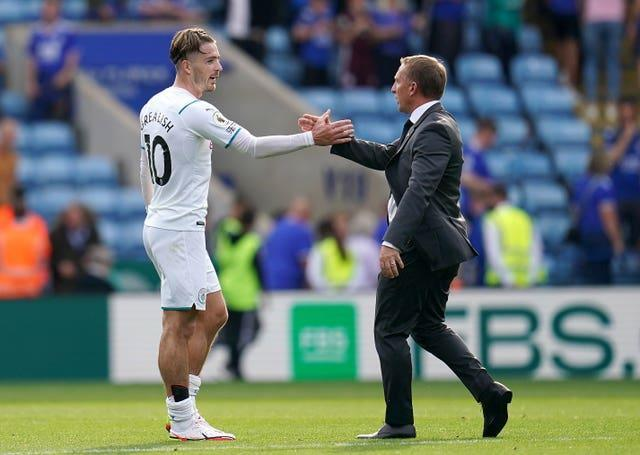 Leicester manager Brendan Rodgers shakes hands with Jack Grealish