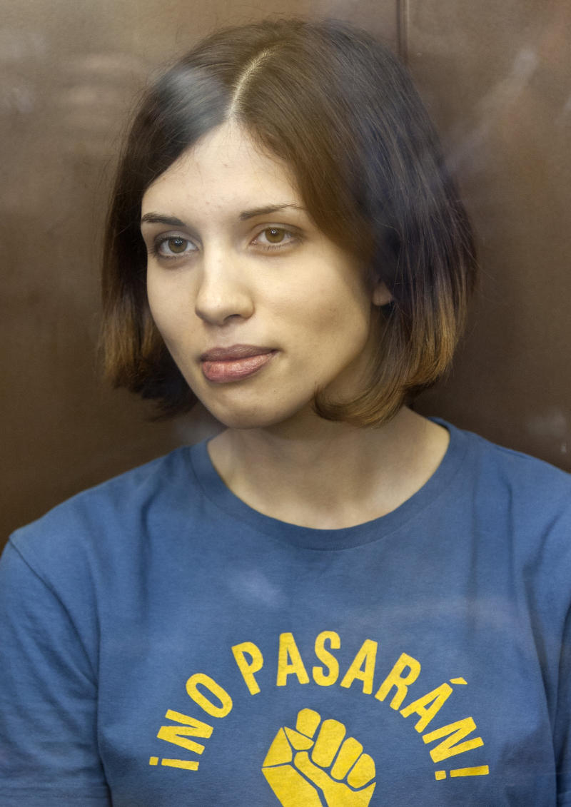 FILE - In this Aug. 17, 2012 file photo, feminist punk group Pussy Riot member Nadezhda Tolokonnikova sits in a glass enclosure at a court in Moscow, Russia. A court in Zubova Polyana opened the hearings on Tolokonnikova appeal for early release Friday morning, April 26, 2013, as dozens of journalists descended on this small town in the central province of Mordovia, home to a sprawling web of Soviet-era prison camps.(AP Photo/Misha Japaridze, File)