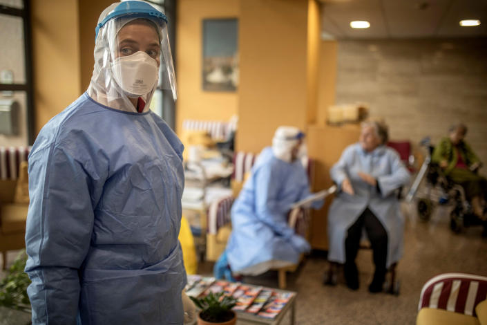 Aid workers from the Spanish NGO Open Arms carry out coronavirus detection tests at a nursing home in Barcelona on April 1. (Santi Palacios/AP)