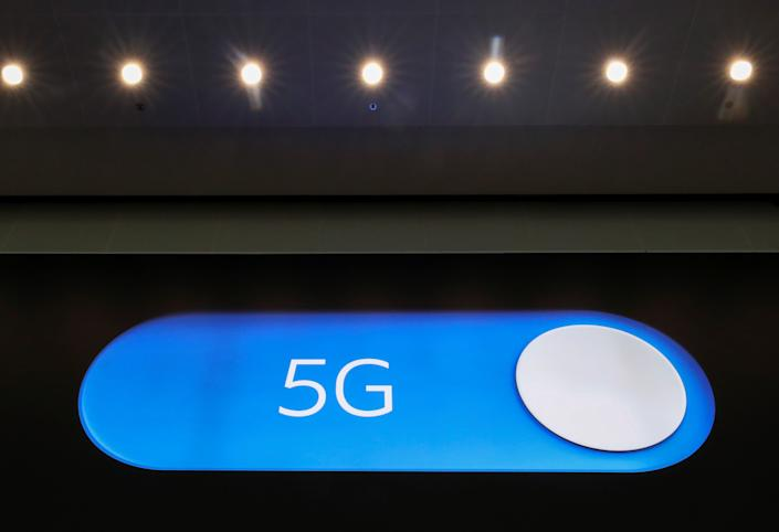An advertising board shows a 5G logo at the International Airport in Zaventem