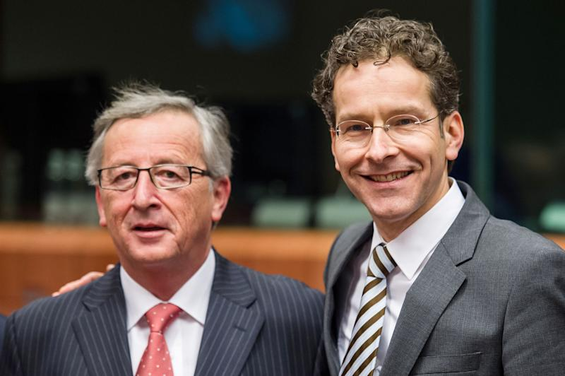 President of the Eurogroup Jean-Claude Juncker, left,  talks with Dutch finance minister Jeroen Dijsselbloem during an Eurogroup finance ministers meeting at the EU Council in Brussels on Monday, Jan. 21, 2013. (AP Photo/Geert Vanden Wijngaert)
