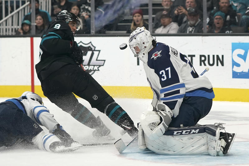Hellebuyck's 51 saves lead Jets past Sharks 3-2