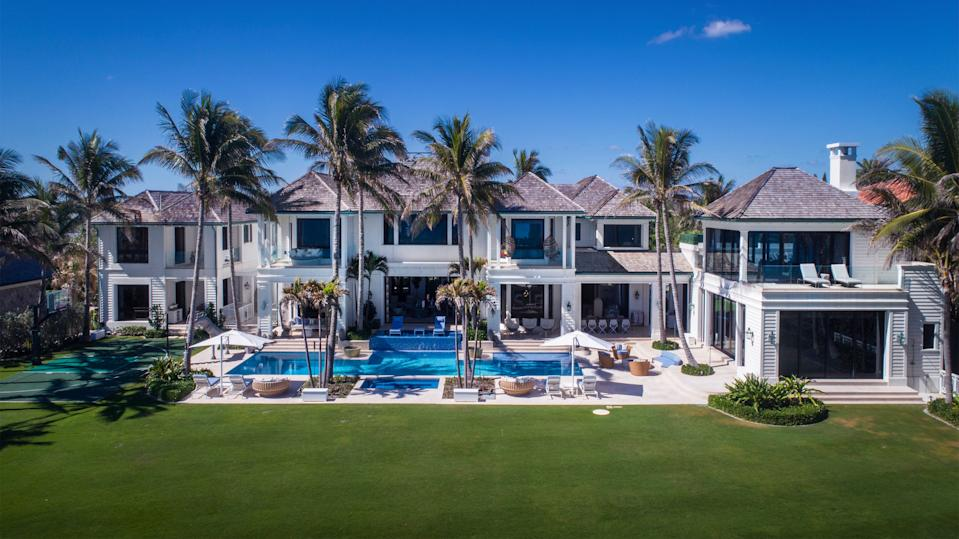 Elin Nordegren built this custom home at 12520 Seminole Beach Road after her 2010 divorce from golf legend Tiger Woods. It has likely sold for a recorded $28.641 million, courthouse records suggest. [Photo by Lifestyle Production Group, courtesy Sotheby's International Realty]