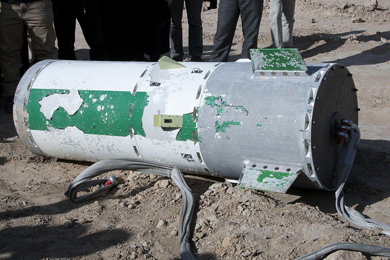 In this photo released on Saturday, Dec. 14, 2013 by the Iranian Students New Agency, ISNA, a capsule lies on the ground containing a monkey named Fargam, or Auspicious, during a mission to send it into space by the rocket dubbed Pajohesh, or Research in Farsi, in an undisclosed location in Iran. Iran said Saturday it has successfully sent the monkey into space for a second time, part of an ambitious program aimed at manned space flight. Iran's state TV said that the launch of the rocket was Iran's first use of liquid fuel. It said the monkey was returned to earth safely. (AP Photo/Iranian Students News Agency) EDS NOTE: THE ASSOCIATED PRESS HAS NO WAY OF INDEPENDENTLY VERIFYING THE CONTENT, LOCATION OR DATE OF THIS IMAGE.