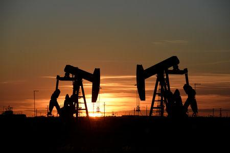 FILE PHOTO: Pump jacks operate at sunset in an oilfield in Texas