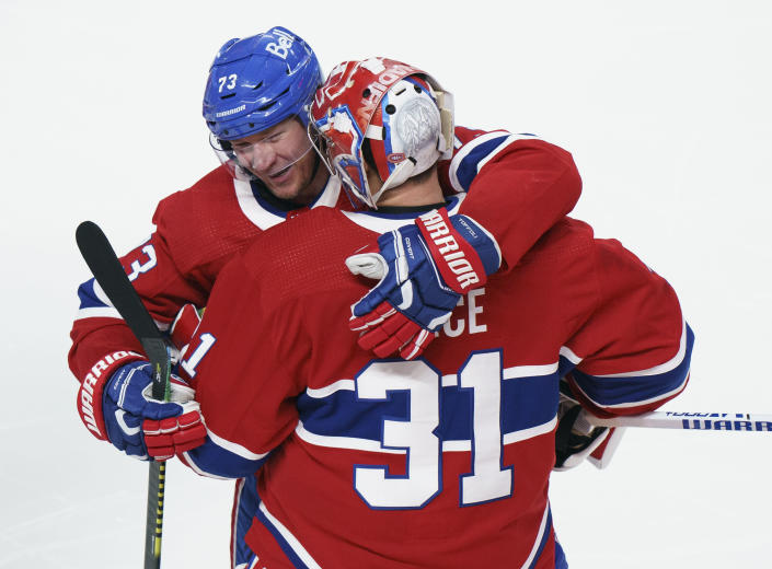Montreal Canadiens' Tyler Toffoli (73) celebrates his winning goal with teammate Carey Price following overtime NHL Stanley Cup playoff hockey action against the Winnipeg Jets in Montreal, Monday, June 7, 2021. (Paul Chiasson/The Canadian Press via AP)