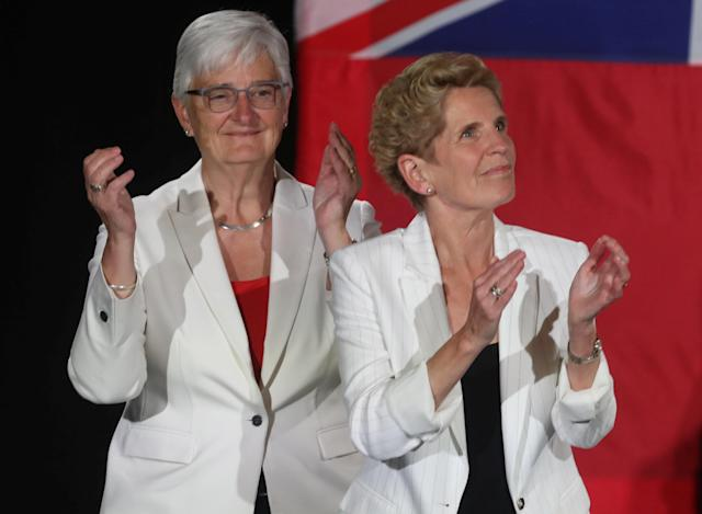 Ontario Premier Kathleen Wynne, with partner Jane Rounthwaite, applaud after voting closed in provincial elections during her campaign event in Toronto, Ontario, Canada June 7, 2018. REUTERS/Fred Thornhill