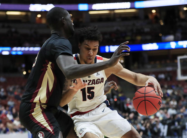 <p>Brandon Clarke #15 of the Gonzaga Bulldogs posts up against Christ Koumadje #21 of the Florida State Seminoles during the 2019 NCAA Men's Basketball Tournament West Regional at Honda Center on March 28, 2019 in Anaheim, California. (Photo by Sean M. Haffey/Getty Images) </p>