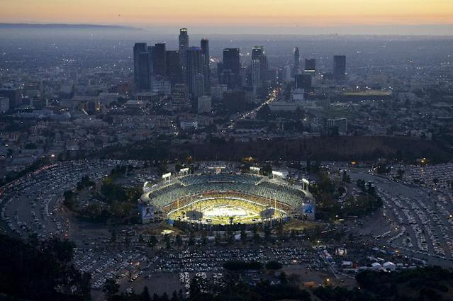 Fans arrive before the start of an NHL outdoor hockey game at Dodger Stadium between the Los Angeles Kings and the Anaheim Ducks in Los Angeles, Saturday, Jan. 25, 2014. (AP Photo/Mark J. Terrill)