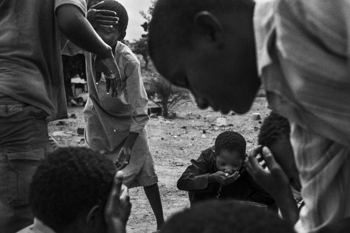 <p>Children that used to be talibes cool off at SOS Talibe Center in Bafata, Guinea-Bissau, June 8, 2015. The center received 45 cases of talibes returning from Senegal in 2014. Some of them ran away from the daaras, but others were handed over by the marabouts to the authorities when they were brought to the courts. (Photograph by Mario Cruz) </p>
