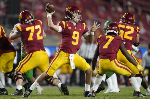 Southern California quarterback Kedon Slovis (9) throws a pass during the second quarter of an NCAA college football game for the Pac-12 Conference championship Friday, Dec 18, 2020, in Los Angeles. (AP Photo/Ashley Landis)