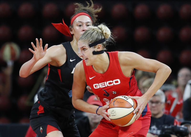 Washington Mystics' Elena Delle Donne drives into Las Vegas Aces' Dearica Hamby during the first half of Game 4 of a WNBA playoff basketball series Tuesday, Sept. 24, 2019, in Las Vegas. (AP Photo/John Locher)