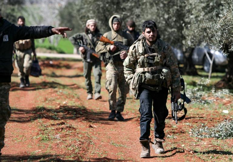 Turkish-backed fighters advance on the key crossroads town of Saraqeb as rebel forces prepare to reverse one of the principal gains of the government's two-month-old offensive